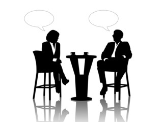 businessman and businesswoman speaking at the table drinking cof