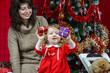 Mother with little daughter finding christmas gifts