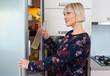 woman near fridge at home