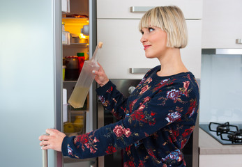 woman near fridge at home