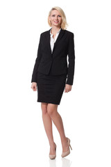 businesswoman wearing black suit, smiling