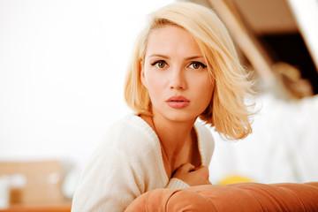 beautiful young woman, wearing a white sweater
