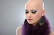 Portrait of hairless woman in purple boa