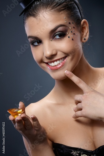 Happy woman with gem