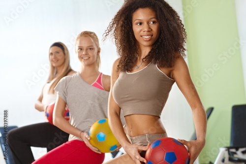 Beautiful afro woman exercising