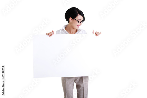 Business woman showing blank signboard