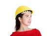 Female worker in helmet looking up.