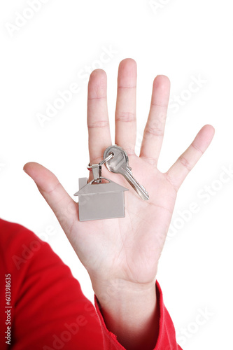Hand holding a house key.
