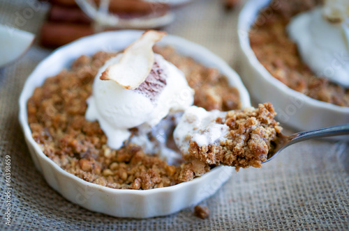 Apple crumble dessert with cinnamon and vanilla ice -cream on wo