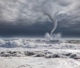 amazing tornado with dramatic sky