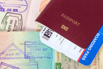 Passport, visa immigration stamps, and boarding pass
