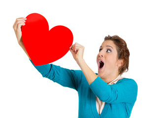 Happy, excited woman holding big red heart