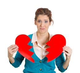 Sad woman holding broken heart