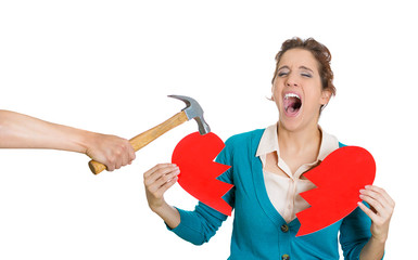 Sad woman holding broken heart
