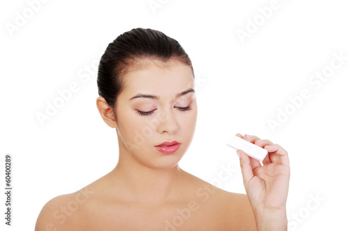 Sad woman with pregnancy test