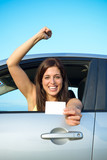 Successful girl passing car driving license test