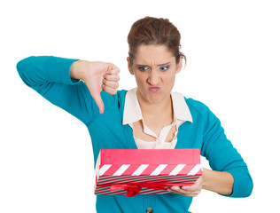woman opening gift box very upset at what she received