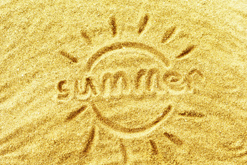 "the word ""summer"" on yellow sand"