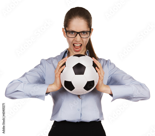 Aggressive girl with a soccer Ball