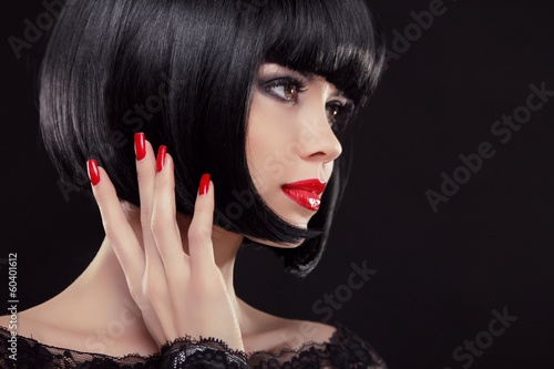 Bob short black hairstyle. Manicured nails and red lips. Fashion