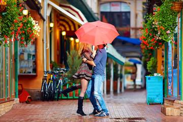 happy couple having fun on colorful street