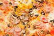 italian pizza with fungi and prosciutto cotto - 60404665