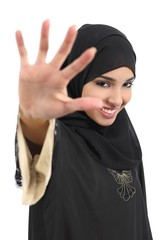 Saudi arab woman saying no photos covering her face with a hand