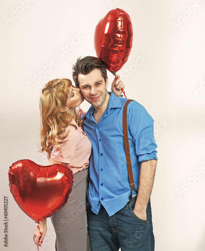 Cute blonde woman kissing her valentine's boyfriend