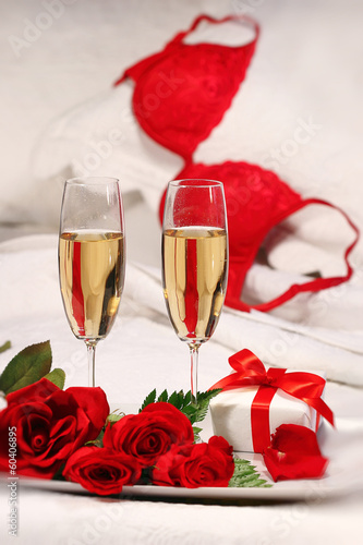 Closeup of champagne glasses and roses