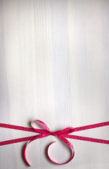 Decorative ribbon with bow .Valentines day background