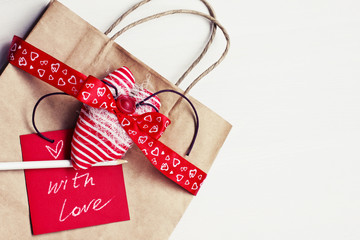 Valentine's gift bag with red ribbon and heart