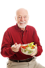 Healthy Senior Man Eating Salad