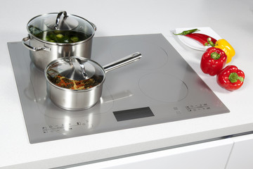 Grey glass induction hob in the kitchen