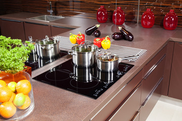 Modern kitchen  with glass induction hob.