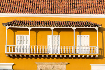 Yellow and White Colonial Balcony