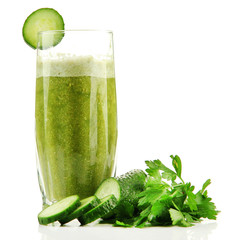 Glass of green vegetable juice and cucumber isolated on white