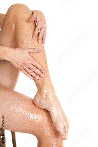Woman legs bare foot wet hands on leg