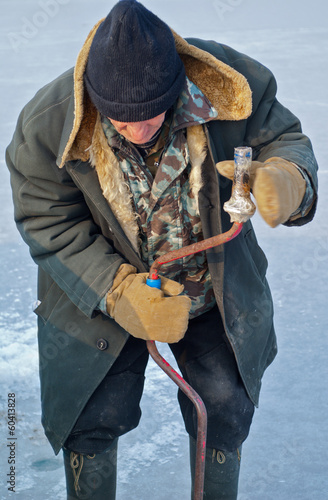 Old man on winter fishing 4