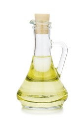 Salad dressing vinegar oil in a glass pouring jug with cork