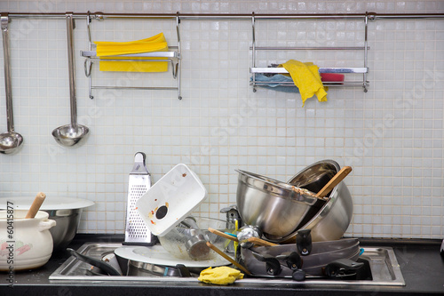 Dirty utensil on the kitchen - 60415877