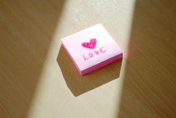 love and heart writing on post it