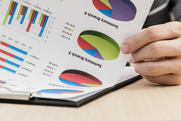 Businessman's hand showing financial report