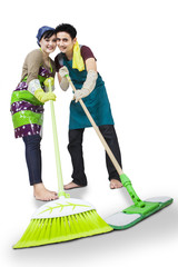Happy couple cleaning the floor isolated
