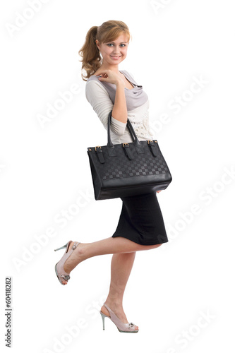 Beautiful cute young girl with a bag in her hand