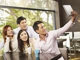 friends taking selfie in cafe poster