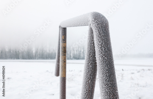 Hoarfrost on a steel construction on a misty day in winter