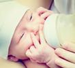 Feeding Baby. Newborn Baby eating milk from the bottle