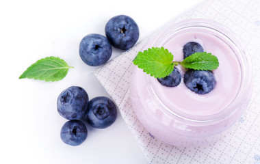 Blueberry berries, leaves of mint and fresh yogurt