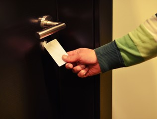 Opening door with a card