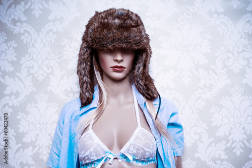 Mannequin in a fur winter hat and lingerie